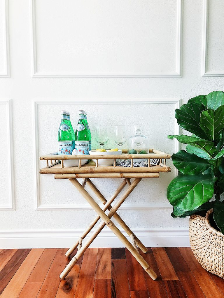 White walls with panel moulding, bamboo bar cart, and fiddle leaf fig-refresh your home decor